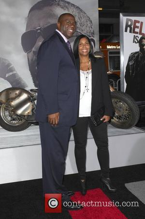 Magic Johnson with wife Cookie Johnson  Los Angeles Premiere of 'The Book Of Eli' held at the Grauman's Chinese...