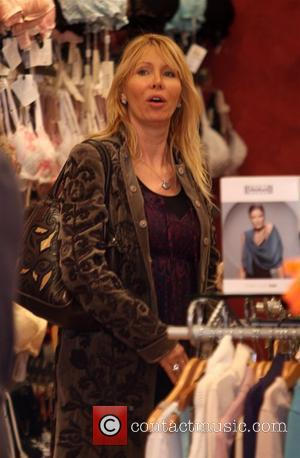 Lisa Gastineau out shopping with her daughter at the 'Under G's Lingerie' boutique in Beverly Hills. Los Angeles, California -...