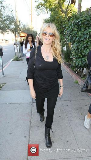 Lisa Gastineau leaving The Little Next Door restaurant in West Hollywood West Hollywood, California - 15.01.11