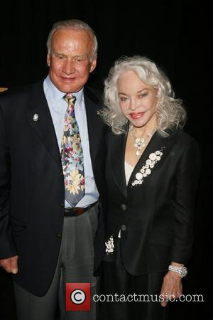 Buzz Aldrin, Lois Driggs Cannon attending a special cocktail party to launch the Broadway Walk of Stars at the NASDAQ...
