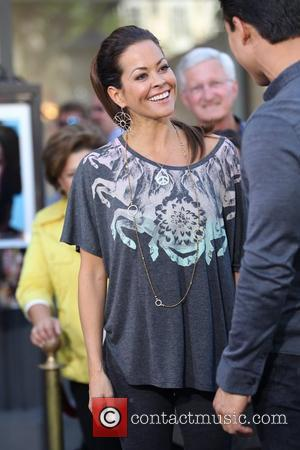 Brooke Burke films an interview with Mario Lopez for the entertainment television news programme 'Extra' at The Grove in Hollywood....