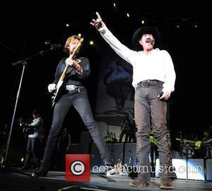 Kix Brooks and Ronnie Dunn of Brooks & Dunn  performing on stage during their Last Rodeo Tour at the...