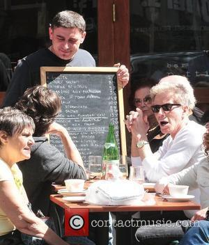 Calvin Klein and friends ordering food at Bar Pitti New York City, USA - 23.04.10