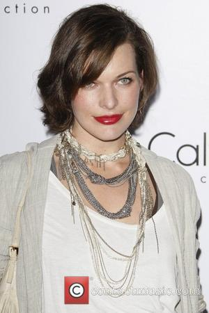 Milla Jovovich Calvin Klein Collection & Los Angeles Nomadic Division (LAND) 1st Annual Celebration For L.A. Arts Monthly and Art...
