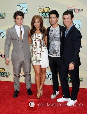Nick Jonas, Joe Jonas, Demi Lovato and Kevin Jonas World Premiere of 'Camp Rock II: The Final Jam' held at...