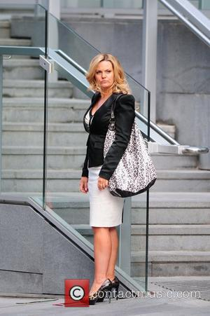 Jo Joyner filming a scene for BBC drama Candy Cabs. Manchester, England - 11.07.10
