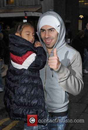 Carlos Tevez  takes his family out for a meal at swanky eatery San Carlos to celebrate his two goals...
