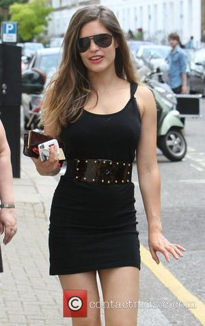 Carly Zucker aka Carly Cole walking in Central London, wearing a short black dress and sunglasses London, England - 03.06.10