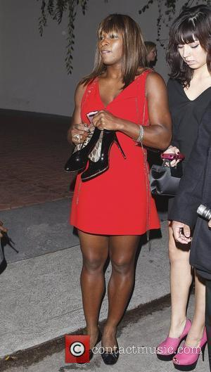 Serena Williams leaving the Grammy Awards house party hosted by William Morrison in Beverly Hills carrying a pair of high...