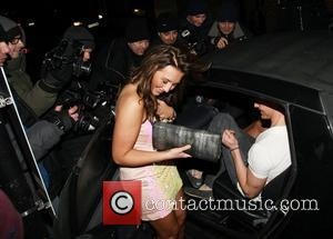 Lauren Goodger leaving Chinawhite nightclub with a friend. The pair got into a friends Smart Car, despite her other friends...