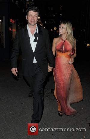 Nick Knowles and a female companion leaving Alto nightclub. London, England - 11.11.10