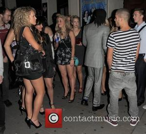 Max George of The Wanted enjoys some female attention as he leaves Movida nightclub London, England - 08.09.10