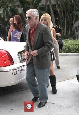 Hugh Hefner Celebrities arrive at the Staples Center to watch the Los Angeles Lakers play Oklahoma City Los Angeles, California...