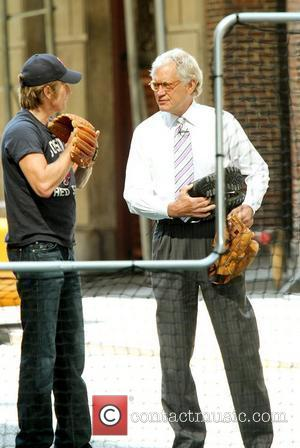 Denis Leary and David Letterman with baseball gloves on for a game of baseball outside the 'Late Show with David...