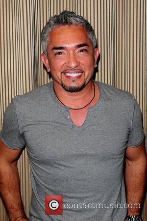 Cesar Millan discusses and signs copies of his new book 'Cesar's Rules: Your Way to Train a Well-Behaved Dog' at...