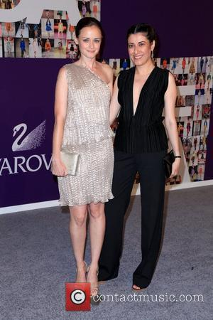 Alexis Bledel and Guest 2010 CFDA Fashion Awards at Alice Tully Hall, Lincoln Center - Arrivals New York City, USA...