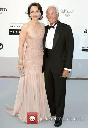 Kristin Scott Thomas and Giorgio Armani  2010 Cannes International Film Festival - Day 9 - amfAR's Cinema Against AIDS...