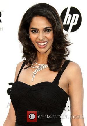 Mallika Sherawat   2010 Cannes International Film Festival - Day 9 - amfAR's Cinema Against AIDS Gala - Arrivals...