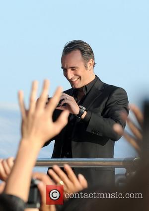 Jean Dujardin attends 'Le Grand Journal de Cannes' at the Majestic Beach Hotel during the 2010 Cannes Film Festival -...