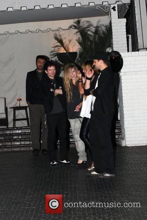 Lavigne Confirms Jenner Rumours With A Kiss