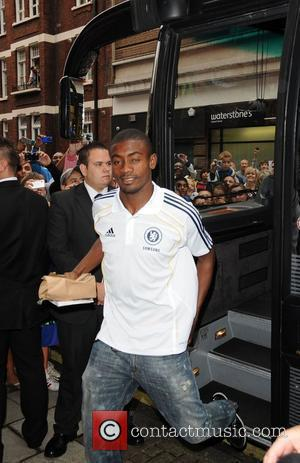 Salomon Kalou Chelsea football players arriving at the Adidas store in Oxford street. London, England - 26.08.10