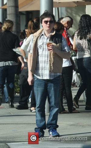 Clark Duke drinking an iced drink while out and about in Beverly Hills Los Angeles, California, USA - 14.01.11