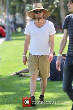 Scott Speedman wearing a wide-brimmed straw hat and sunglasses at the Coachella Music Festival - Day 1 Indio, California -...
