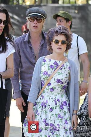 Kelly Osbourne, Sporting A Purple Hair, Her Boyfriend, Luke Worrall, Seen At The 2010 Coachella Valley Music and Arts Festival - Day 1