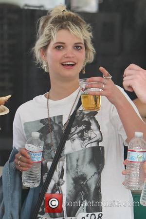 Pixie Geldof wearing a sexually explicit t-shirt and with a pint of beer at the 2010 Coachella Valley Music and...
