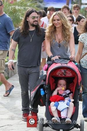 Dea de Matteo and Shooter Jennings with their daughter Alabama Gypsy Rose at the 2010 Coachella Valley Music and Arts...