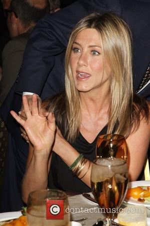 Aniston Dates Cougar Town Co-star