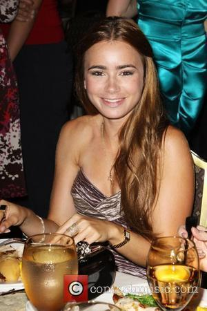 Lily Collins The 2010 Crystal + Lucy Awards: A New Era held at The Hyatt Regency Century Plaza in Century...