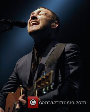 David Gray   performing on stage at the Molson Canadian Amphitheatre.   Toronto, Canada - 27.08.10