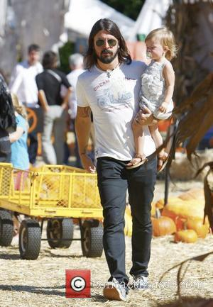 Foo Fighters and Them Crooked Vultures rocker, Dave Grohl, with his daughter Harper Willow, enjoying a family day out at...