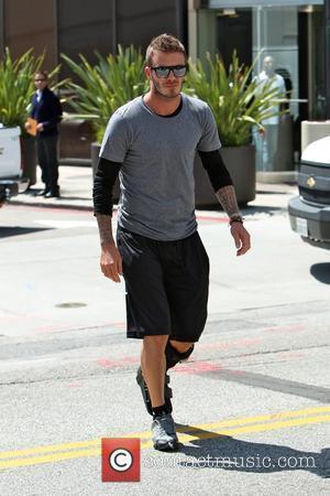 David Beckham seen arriving at the Pinkberry frozen yoghurt store in Beverly Hills. Beckham is still wearing a leg cast...
