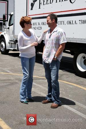 Carolyn Hennesy and Wally Kurth The 'Daytime Gives Back' Feed The Children Event at the Salvation Army Van Nuys, California...