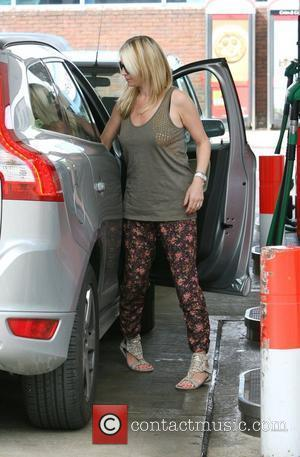 Denise van Outen  stops by a petrol station to fill up her car in North London London, England -...