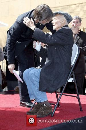 Viggo Mortensen gives Dennis Hopper a hug Dennis Hopper is honored with the 2,403rd Star on the Hollywood Walk of...