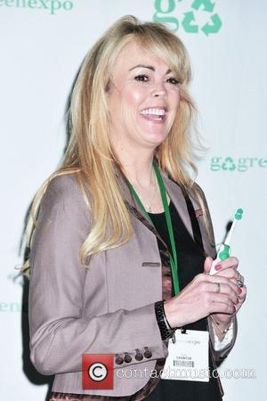 Dina Lohan  introduces the 'Aqua Freedom Green Lohan Toothbrush' at Pier 92 New York City, USA _ 19.03.10