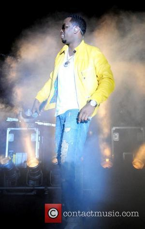 Sean 'Diddy' Combs with his group Dirty Money, performs on stage at the Florida Marlins Super Saturday Concert in the...