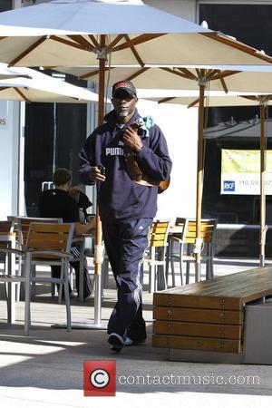 Djimon Hounsou arrives at a gym wearing a stuffed dragon toy attached to his bag Los Angeles, California - 04.12.09