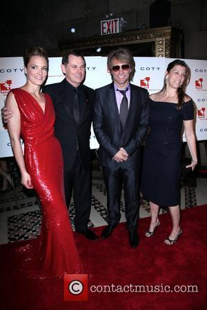 Jon Bon Jovi and his wife Dorothea Hurley pose with guests DKMS' 4th Annual Gala 'Linked Against Leukemia' at Cipriani...