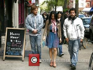 Michael C. Hall, Lucy Liu and director/writer Michael Knowles (right) on the film set for East Fifth Bliss New York...