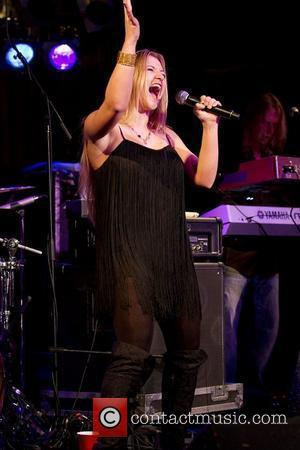 Veteran rocker Eddie Money's daughter Jessie performs at BB King's Bar and Grill located at Times Square in New York...