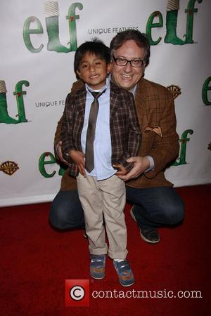 Douglas Carter Beane and his son Cooper Opening night of the Broadway musical production of 'Elf' at the Al Hirschfeld...