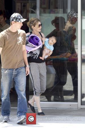 Ellen Pompeo and Stella Luna Ivery Ellen Pompeo has her hands full as she leaves Golden Bridge Yoga carrying her...