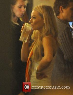 Emma Rigby realxes with a drink in a West End pub, having earlier performed in the musical 'Wolfboy' at the...