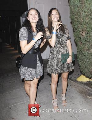 Emmy Rossum  and a friend are seen leaving the Troubadour after a concert in West Hollywood. Los Angeles, California...
