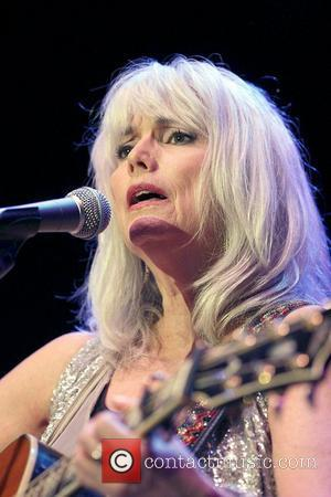 EmmyLou Harris conducts a free concert to a crowd of thousands on 'Festival First Night' as the opening act in...