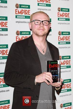 Simon Pegg accepts award for Best Sci-Fi/Fantasy for Star Trek The Empire Film Awards 2010 - press room London, England...
